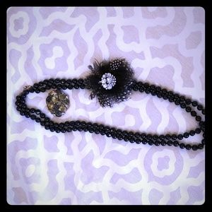 Beaded necklace with two brooches